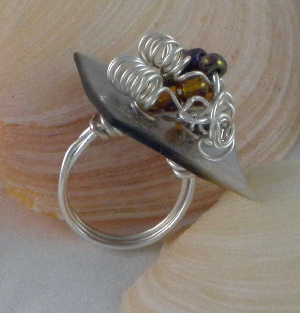 You'll find cute little jewels like this at the Junebug Jewelry Designs stand.