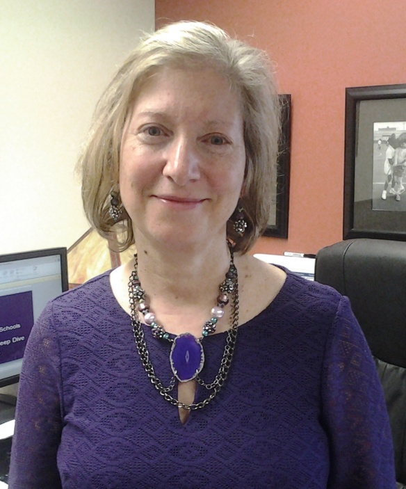 Janet looks wonderful in the Amethyst Swirl Agate, Pearl and Chain Necklace. She got the earrings, too!