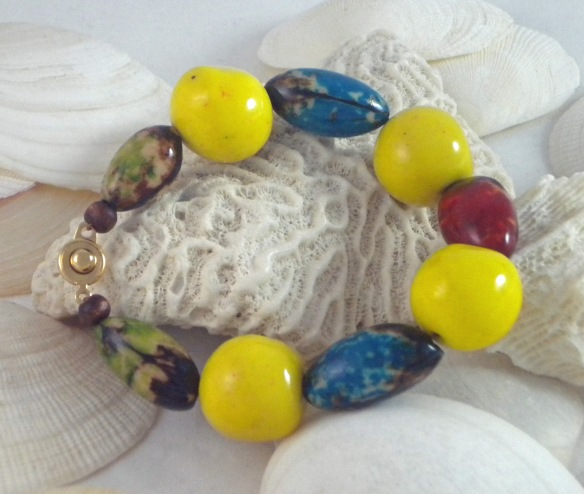 Yellow, Blue, Red and Green Tagua Bead Bracelet by Junebug Jewelry Designs