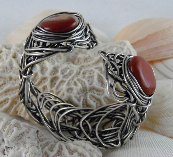 The Red Eye Scribble Bracelet from Junebug Jewelry Designs