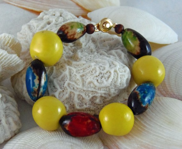 The Yellow, Blue, Red and Green Tagua Bead Bracelet. Pair this bracelet with others from the collection for super-bold color.