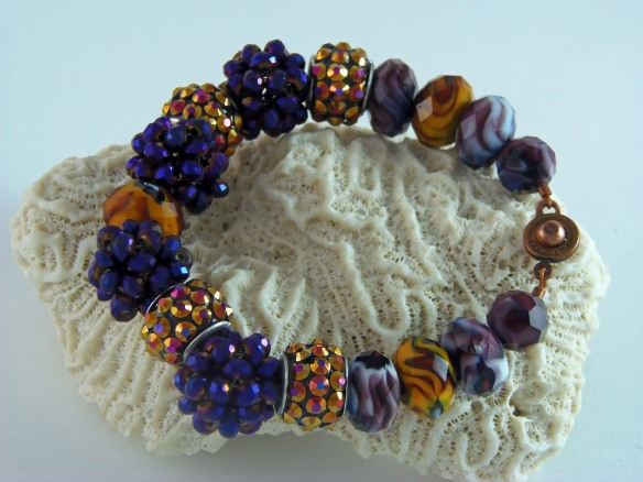 The Purple, Amber and Amethyst Swirl Bling Ball Bracelet from Junebug Jewelry Designs