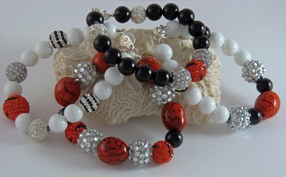 An assortment of Cincinnati Bengals-inspired Team Bling Ball Bracelets from Junebug Jewelry Designs