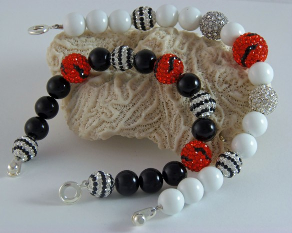 Two Team Bling designs celebrating the Cincinnati Bengals. They look great together. From Junebug Jewelry Designs