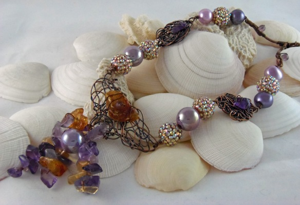 The Amethyst and Amber Gemstone Statement Necklace from Junebug Jewelry Designs